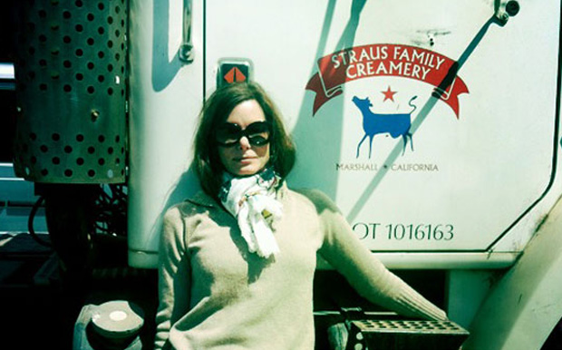 Suzy Kellems Dominik, Founder & Publisher for Of Wit & Will, in front of Straus Family Creamery
